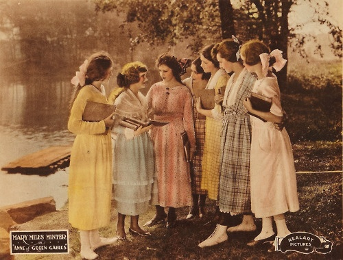 vintage photo of several young women standing and talking with books